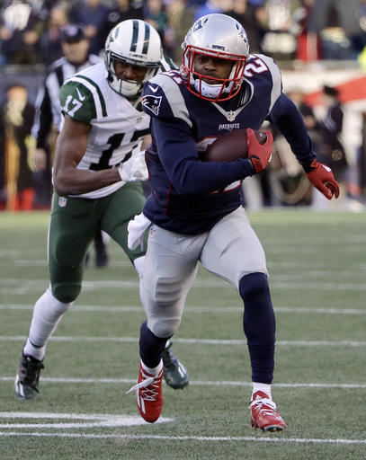 New England Patriots cornerback Malcolm Butler (21) runs with the ball after intercepting a pass intended for New York Jets wide receiver Charone Peake (17) during the second half of an NFL football game, Saturday, Dec. 24, 2016, in Foxborough, Mass. (AP Photo/Elise Amendola)