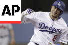 Kershaw allows 2 hits, Dodgers blank Braves 3-0 for 2-0 lead