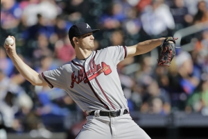 FILE- Atlanta Braves starting pitcher Mike Soroka winds up during the first inning of a baseball game against the New York Mets, Sunday, Sept. 29, 2019, in New York. (AP Photo/Kathy Willens)