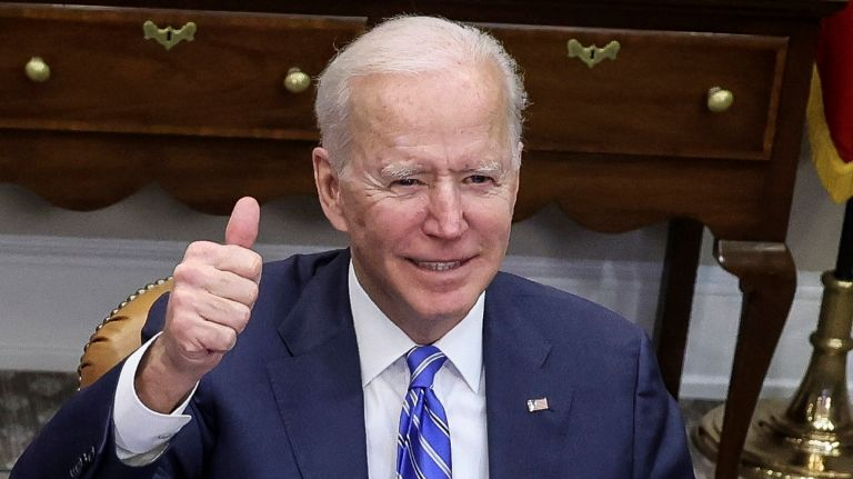 President Joe Biden gives a thumbs up as he speaks during a virtual call on March 4. (Photo: Oliver Contreras via AP)