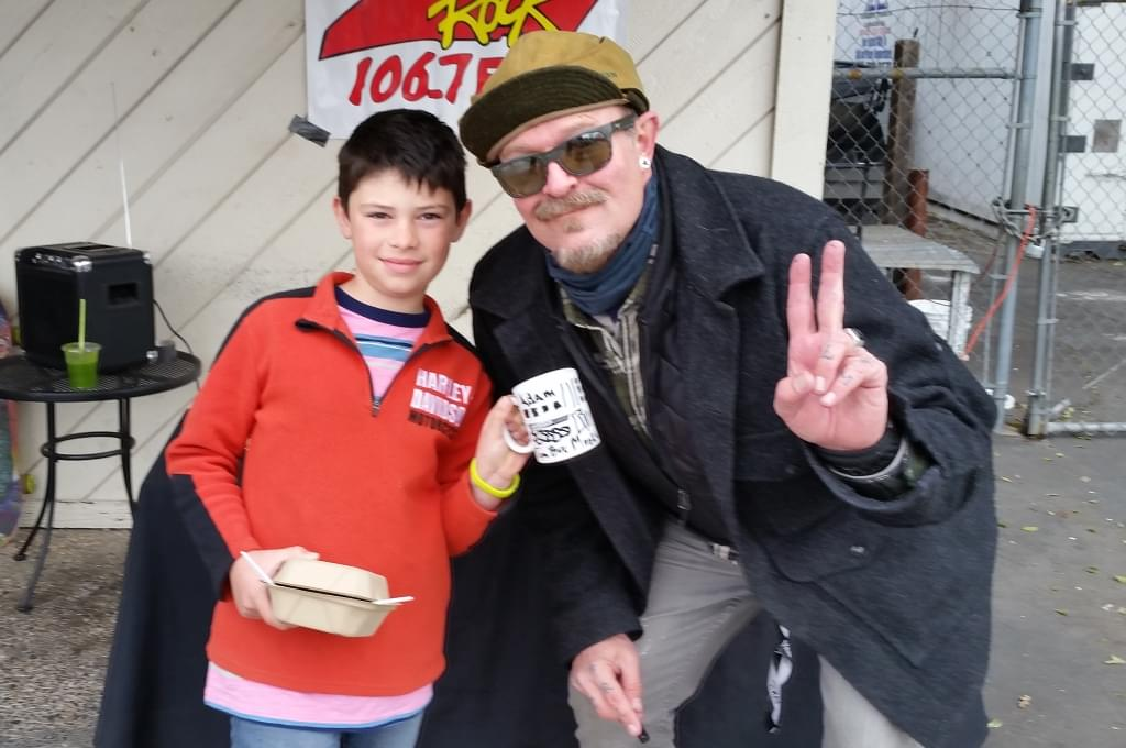 Tim Buc Moore posing with a listener at Wake the Buc Up in North Chico at Fresh Twisted Cafe