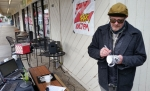 Tim Buc Moore signing a Z-Rock doodle mug at Wake the Buc Up in Chico at Fresh Twisted Cafe.