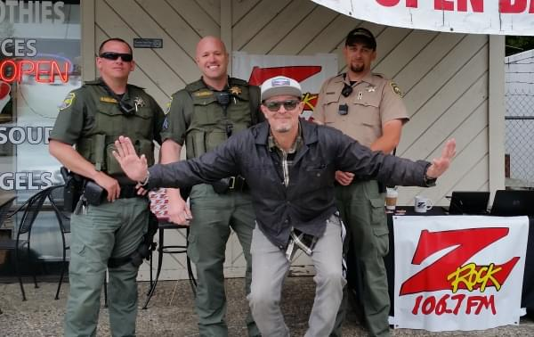 Tim Buc Moore posing with police at Wake the Buc Up in North Chico at Fresh Twisted Cafe