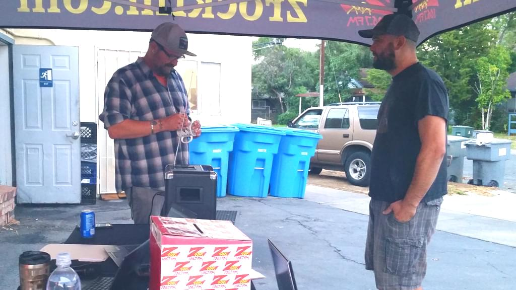 """Tim Buc Moore customizing a Z-Rock """"doodle"""" mug for a listener at Lots 'A Java in Oroville for Wake the Buc Up October 4th 2018"""