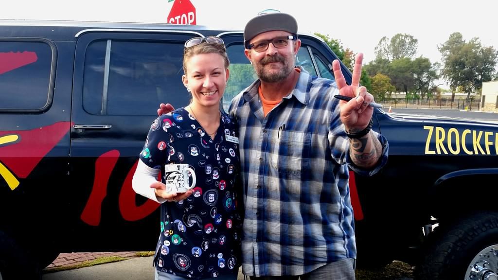 Tim Buc Moore with a listener at Wake the Buc Up in Oroville at Lots 'A Java Thursday October 4th 2018