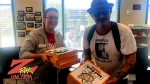 Tim Buc Moore with winner from Chico State Registrar's Office for the Z-Rock Munch Box