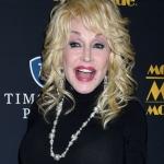 Dolly Parton Recreates Playboy Shoot For Husband Carl's 79th birthday! {Watch}