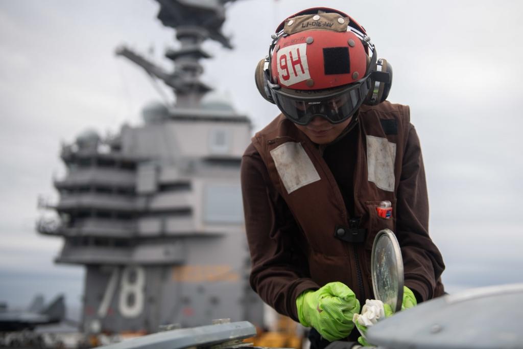 U.S. Sailor does maintenance on an MH-60S Sea Hawk