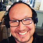 Headshot of Morning News Express Host Ryan Hedrick
