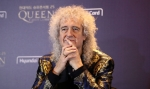 Queen's Brian May Has an Altercation with a Persistent Reporter
