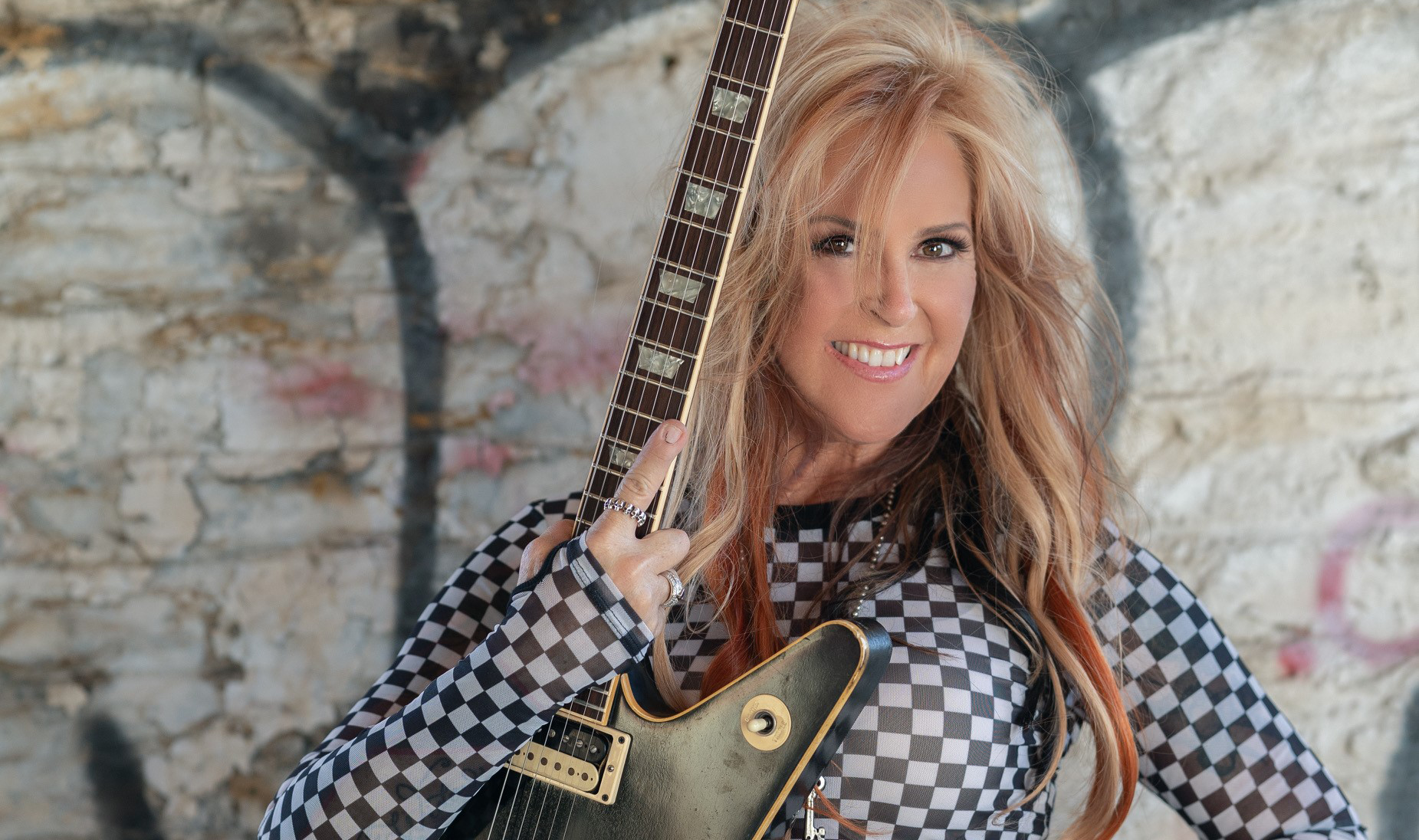 Lita Ford Checks-in with Marci Wiser