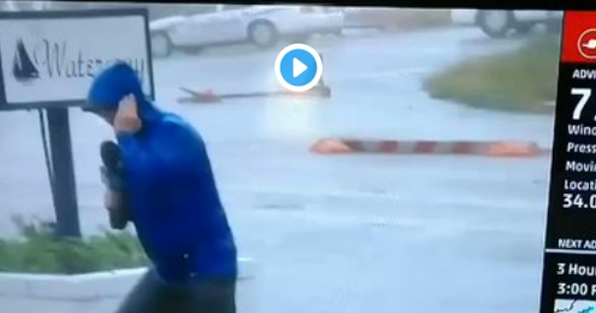 FAIL: Weatherman dramatically braces for winds as two men walk by