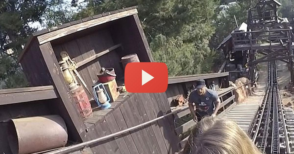 Watch: Man steps off Disneyland roller coaster to retrieve his phone!