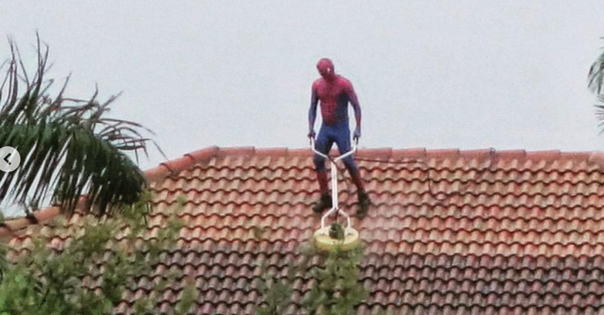 Man Dressed as Spiderman Seen Power Washing Roof