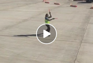 Dancing Airport Worker