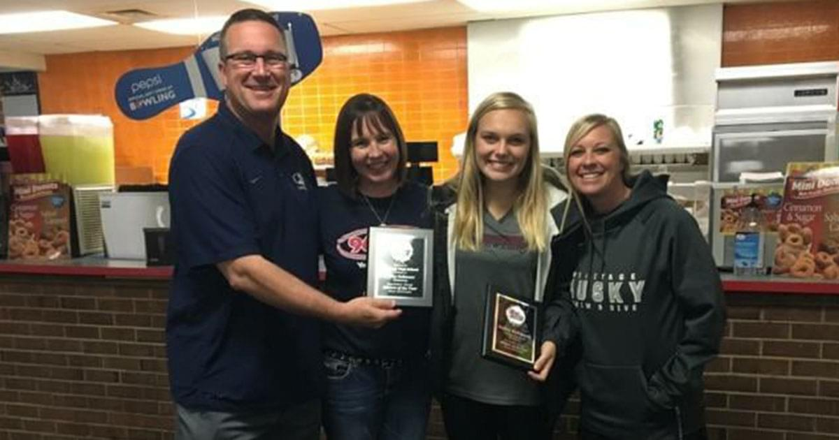 Bailey from Heritage High gets her plaque for Athlete of the Month!