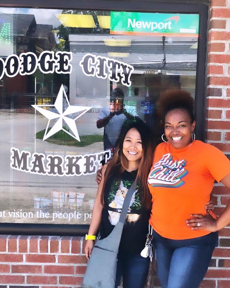 Jane Dough & Christine Webster pose in front of Dodge City Market