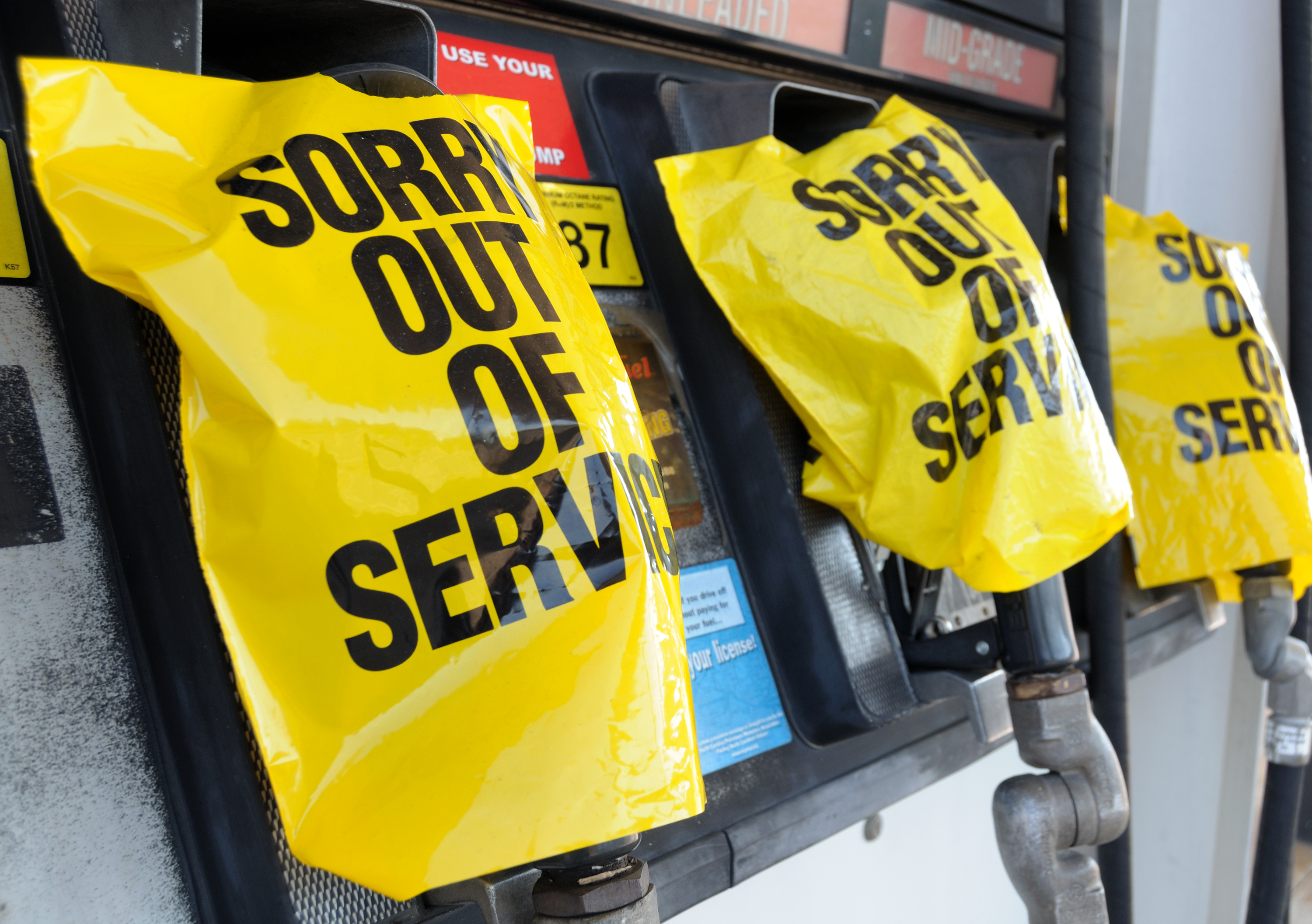 """Empty,Gas,Pump,With,""""out,Of,Service"""",Notices."""