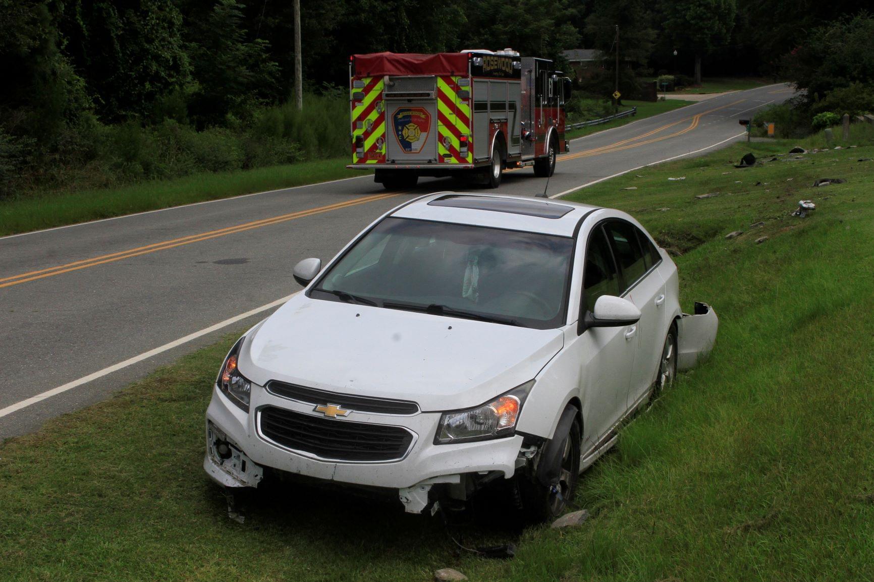 Vehicle Runs Off Road Near Rosewood (PHOTOS)