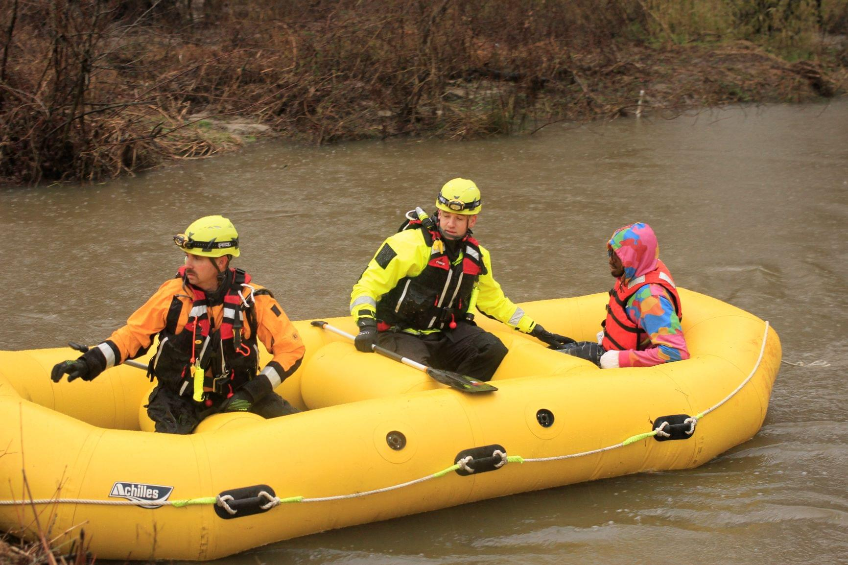 Driver Rescued After Vehicle Ends Up In Creek (PHOTO GALLERY)