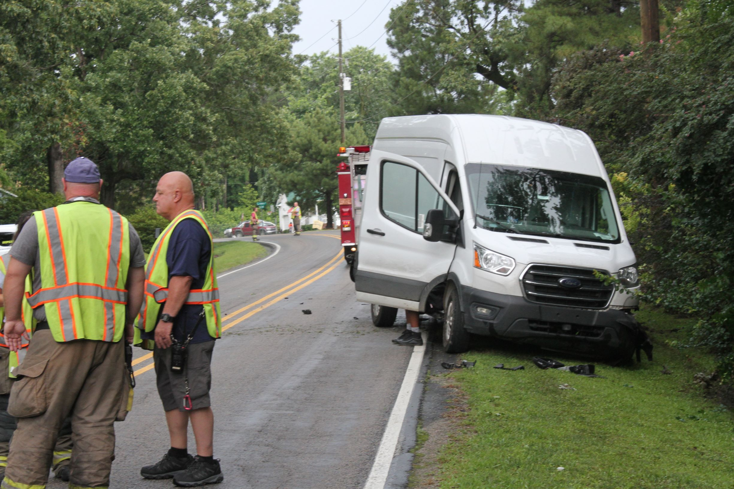 SUV Crashes Into Van Delivering Packages (PHOTOS)