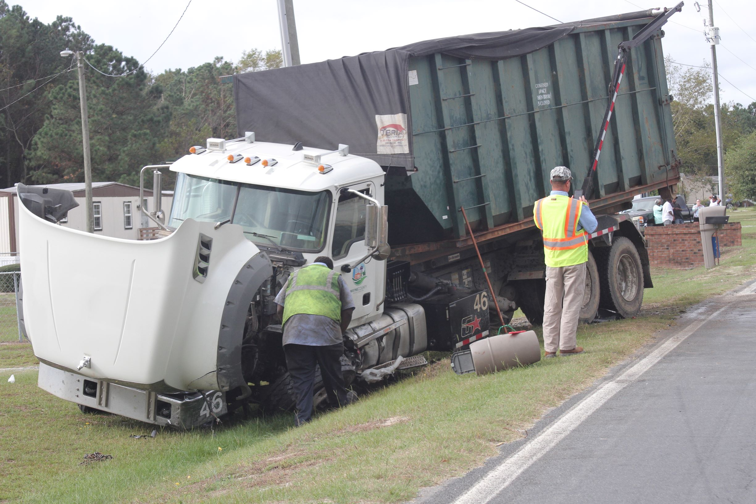 Car, Sanitation Truck Collide On Durham Lake Road (PHOTO GALLERY)