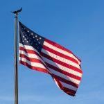 USA stars and stripes flag against blue sky