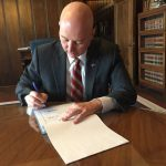 Gov. Ricketts signs budget with flood relief, scholarships