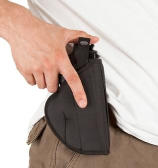 Close-up of a man with his hand on a gun
