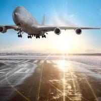 Passenger airplane landing on runway in airport.