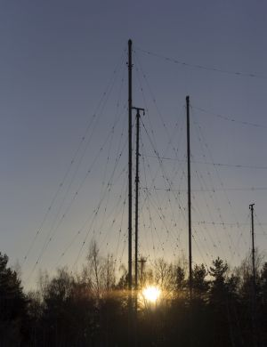 Silhouette Antenna against the sky at sunrise.