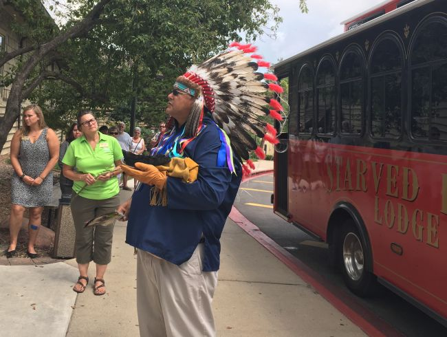 Chief White Winnebago (Jerry Savage) talks to a crowd in front of Starved Rock Lodge.