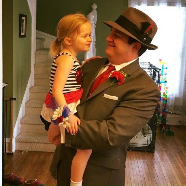 Campaign picture of candidate Chris Minelli holding a child