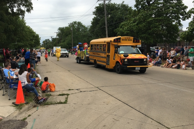 Riverfest parade entry, school bus pulling float with Mario, Pekachu characters