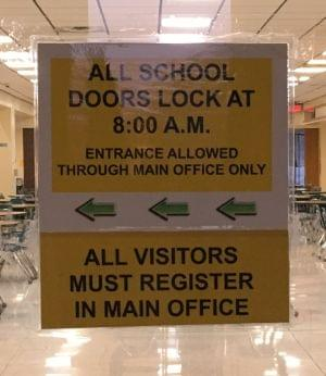 Seneca High School doors locked sign