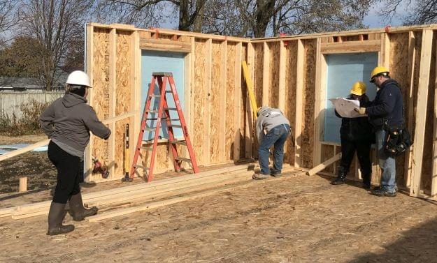 Habitat For Humanity volunteers' work becomes very visible