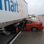 Car slides under semi-trailer on I-39, both people inside face charges
