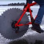 Engineer replaces bike tires with saw blades to ride on ice.