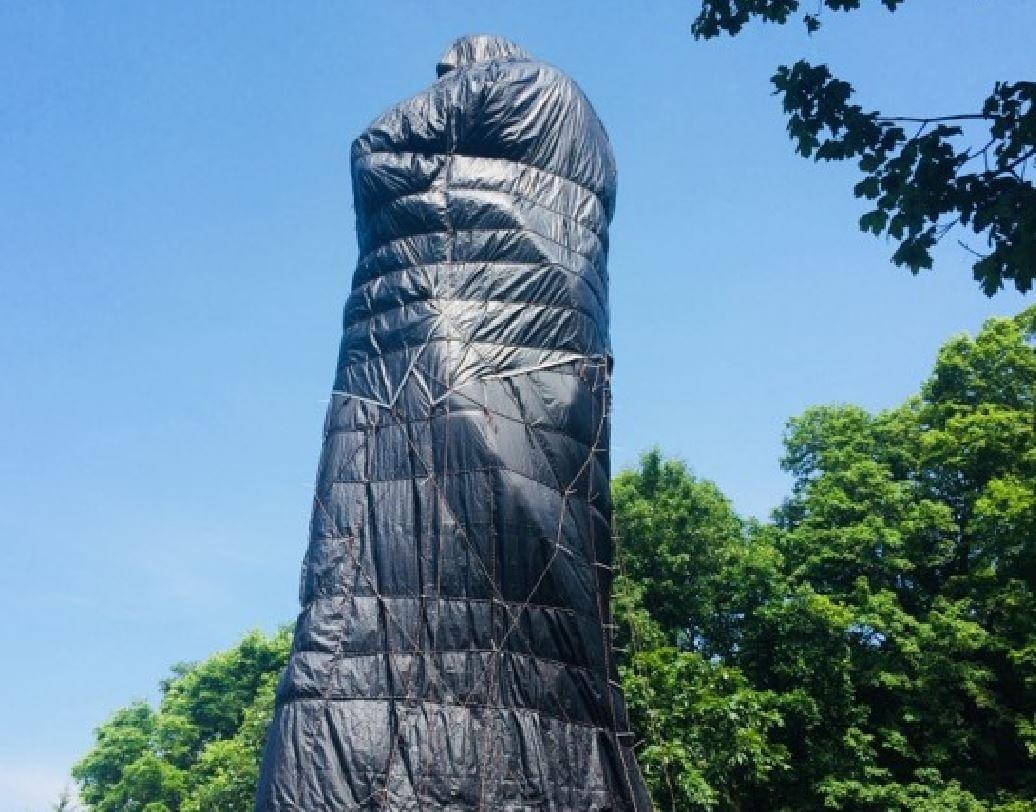 Blackhawk Statue Remains Covered While State Slowly Turns the Wheel