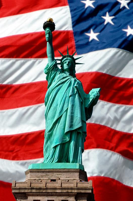 Statue of Liberty superimposed over waving American flag