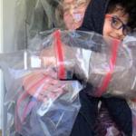 Teacher Creates Plastic Barrier To Hug Students