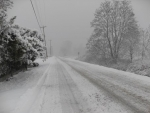 Major highways have slick spots; others ice and snow-covered Tuesday morning