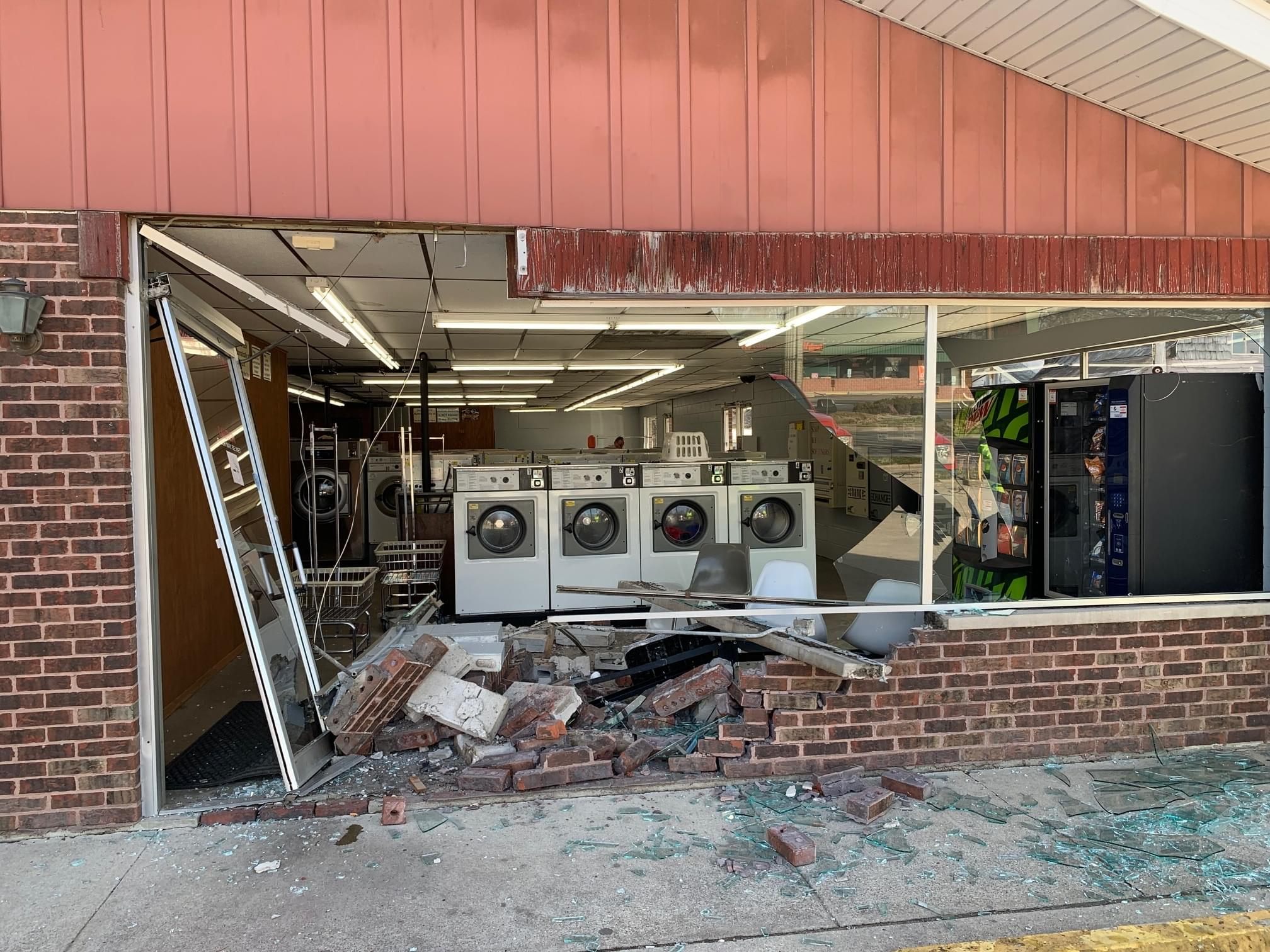 Car hits West Main laundromat causing extensive damage