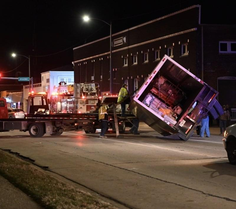 No one injured when car slides under box truck carrying mail in downtown Centralia