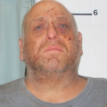 Father charged with stabbing son in Baker County
