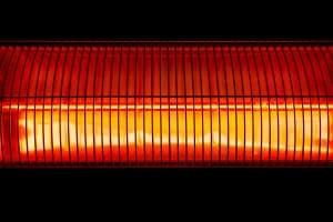 Halogen wall heater abstract close up shot on black background.