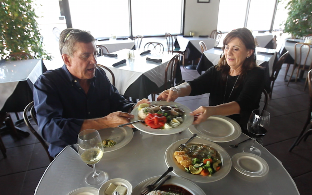 Claire Uricchio has Richard Beene sample one of her restaurant's signature dishes -- the Tri Salad.