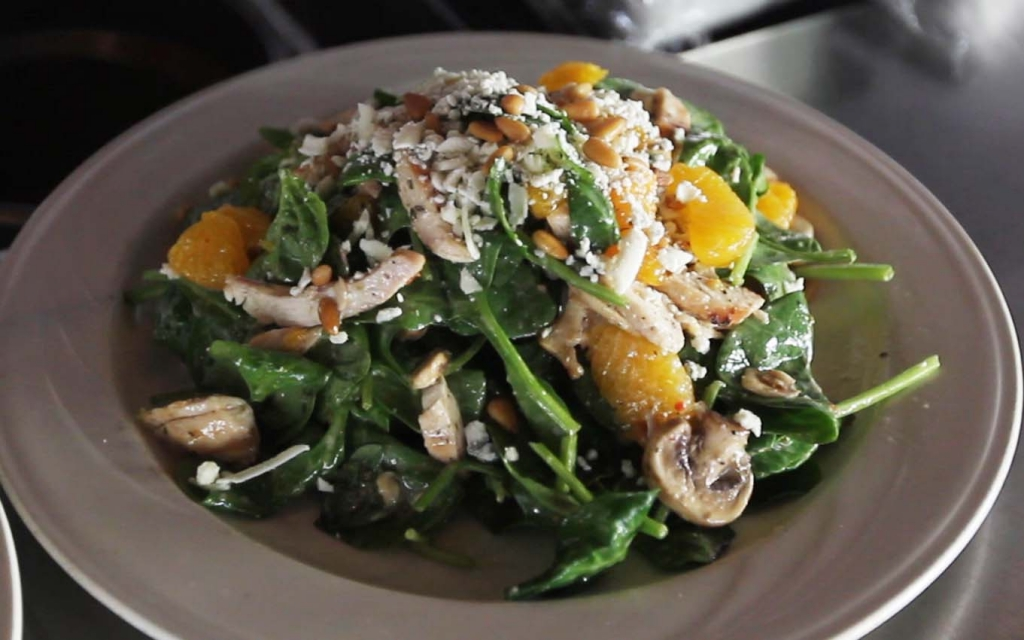 The spinach salad features chicken and mandarin oranges, and Richard Beene described it as one of his most favorite dishes he sampled during his visit to the downtown Bakersfield restaurant. Fresh Spinach with julienne of grilled chicken, sliced mushrooms, mandarin oranges, pine nuts - tossed in a vinaigrette dressing, topped with gorgonzola cheese.