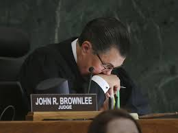 On National Adoption Day, Judge John Brownlee shares his own personal story