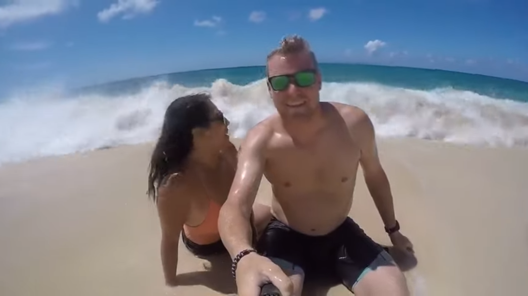 WATCH: Woman Gets Swept Away by Wave While Her Husband Takes Selfie